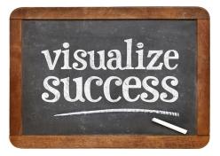 visualize success advice - white chalk text  on a vintage slate